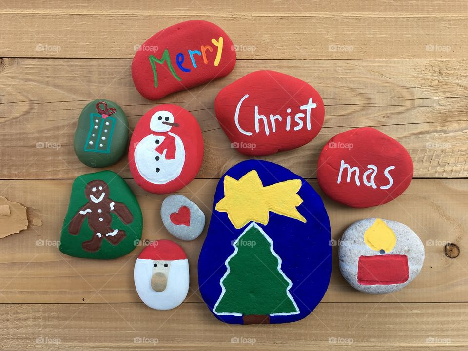 Christmas symbols on colored stones