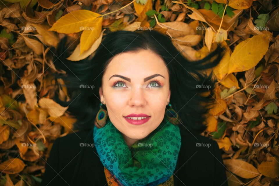 Laying on autumn leaves