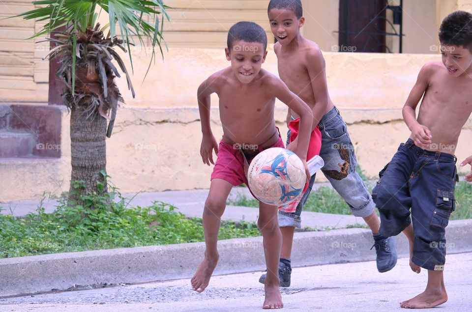 Children Playing Football In The Street