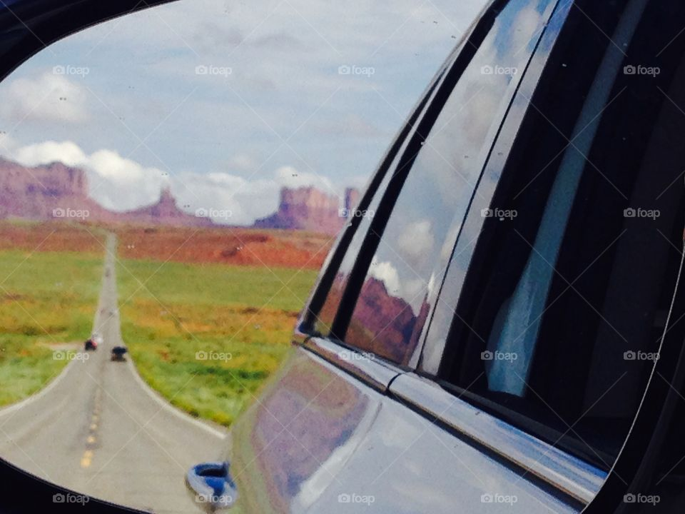 Monument Valley skyline took in the rear-view mirror
