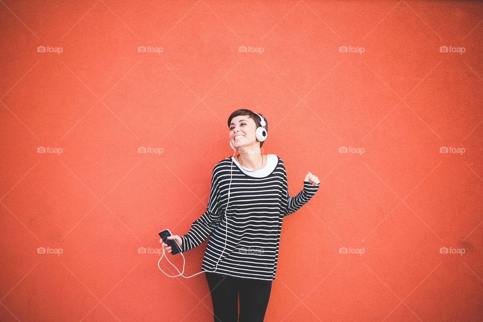 Woman listening music with headphone