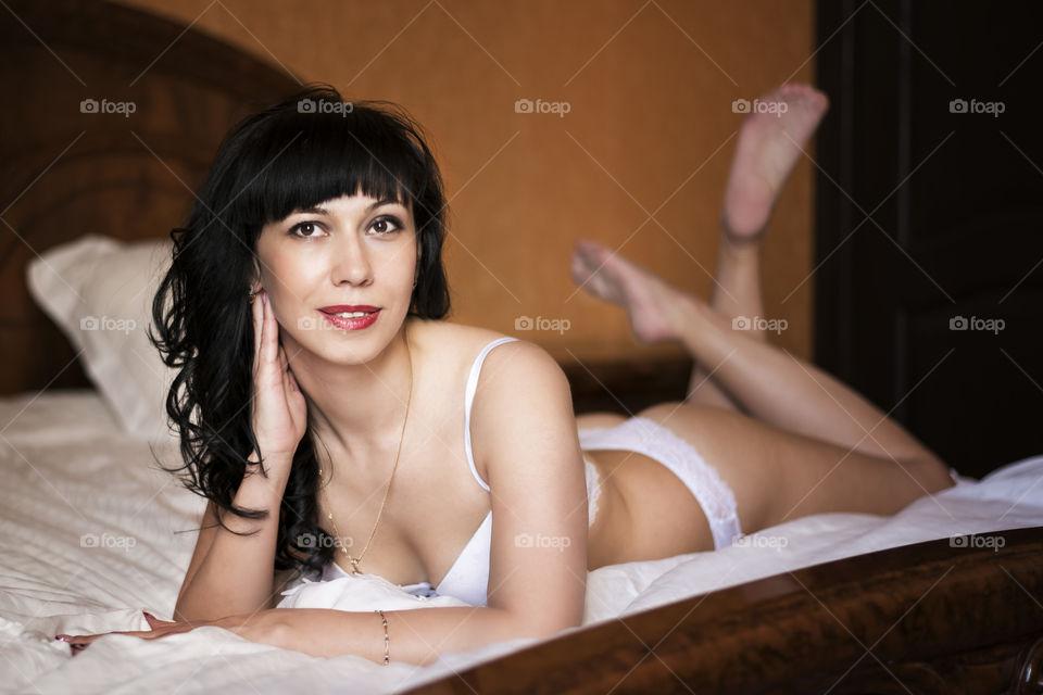 Woman on bikini lying on bed