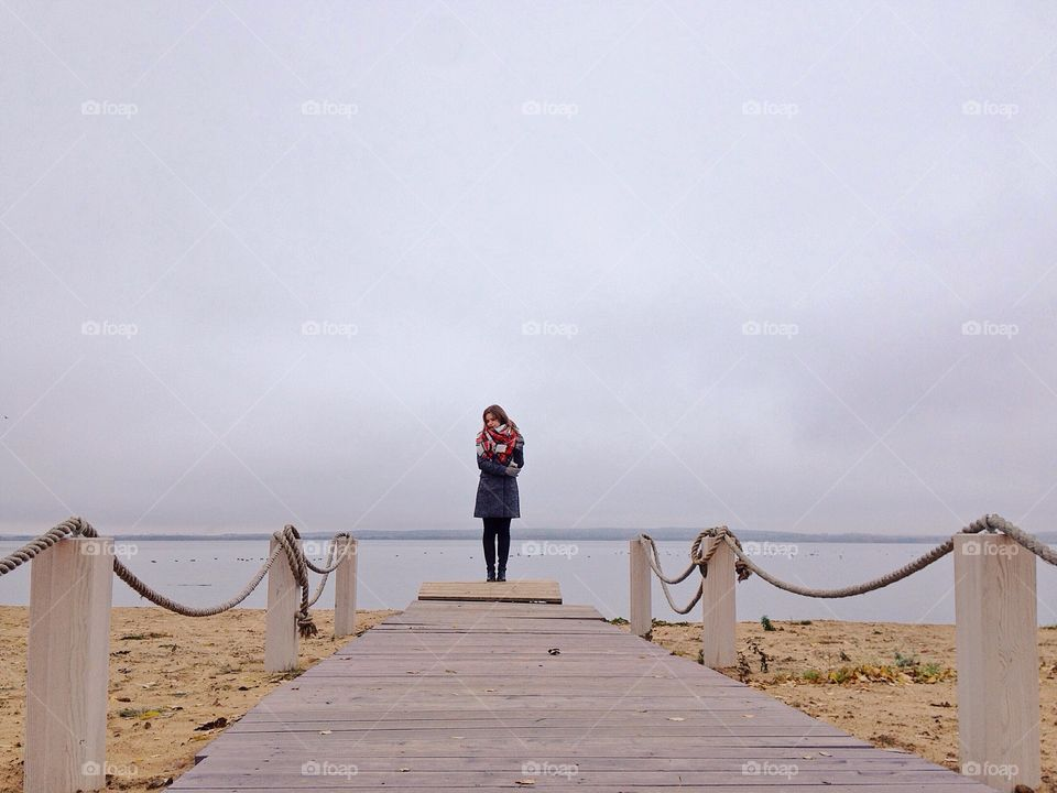 Woman staying on the beach