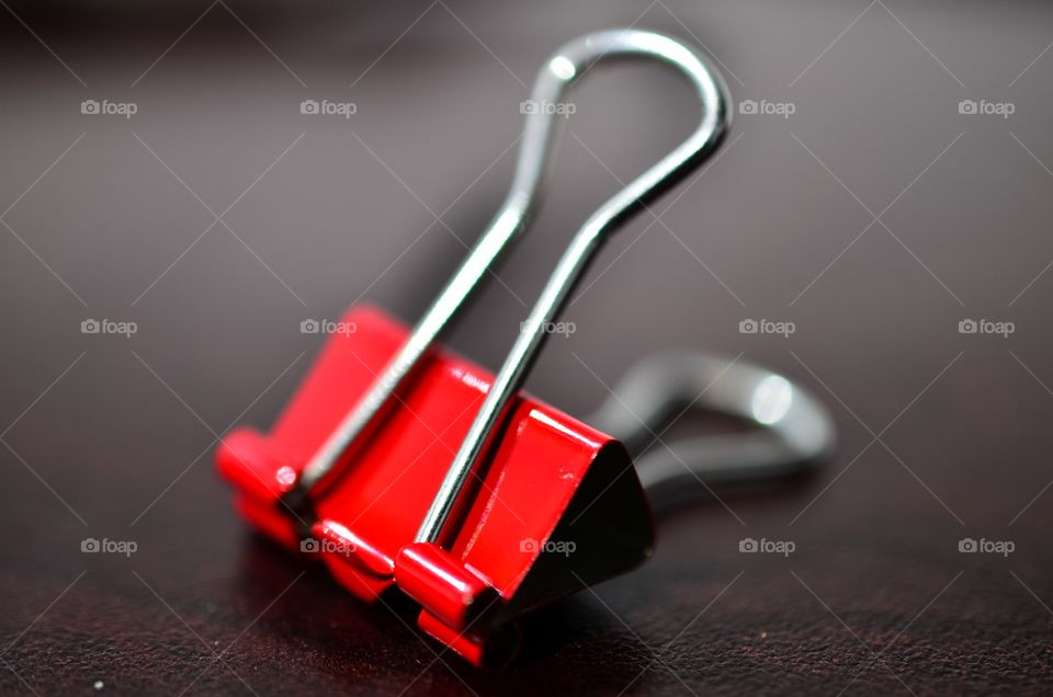 Close-up of red binder clip
