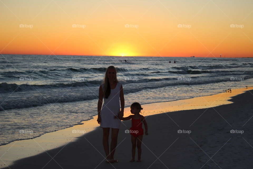 Mother daughter watching the sunset