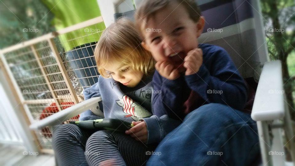 Siblings using tablet