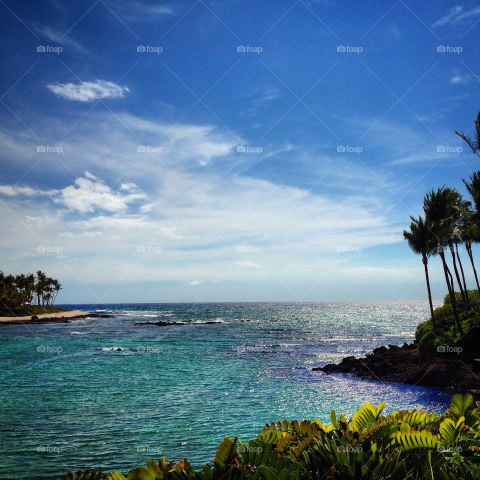 Blue sea against sky