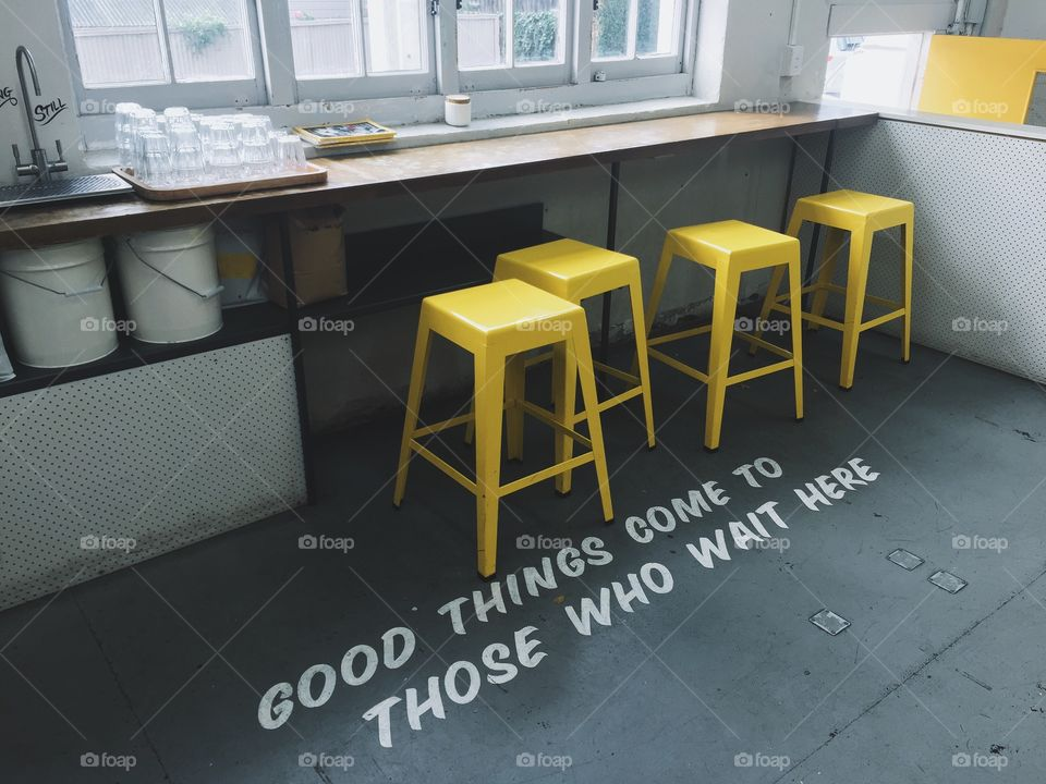Follow the yellow seat row. A simple but beautiful coffee shop with yellow accents