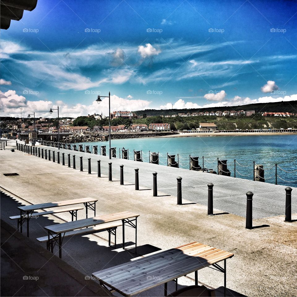 The view of Folkestone Seafront from the recently renovated pier on a warm summers day.