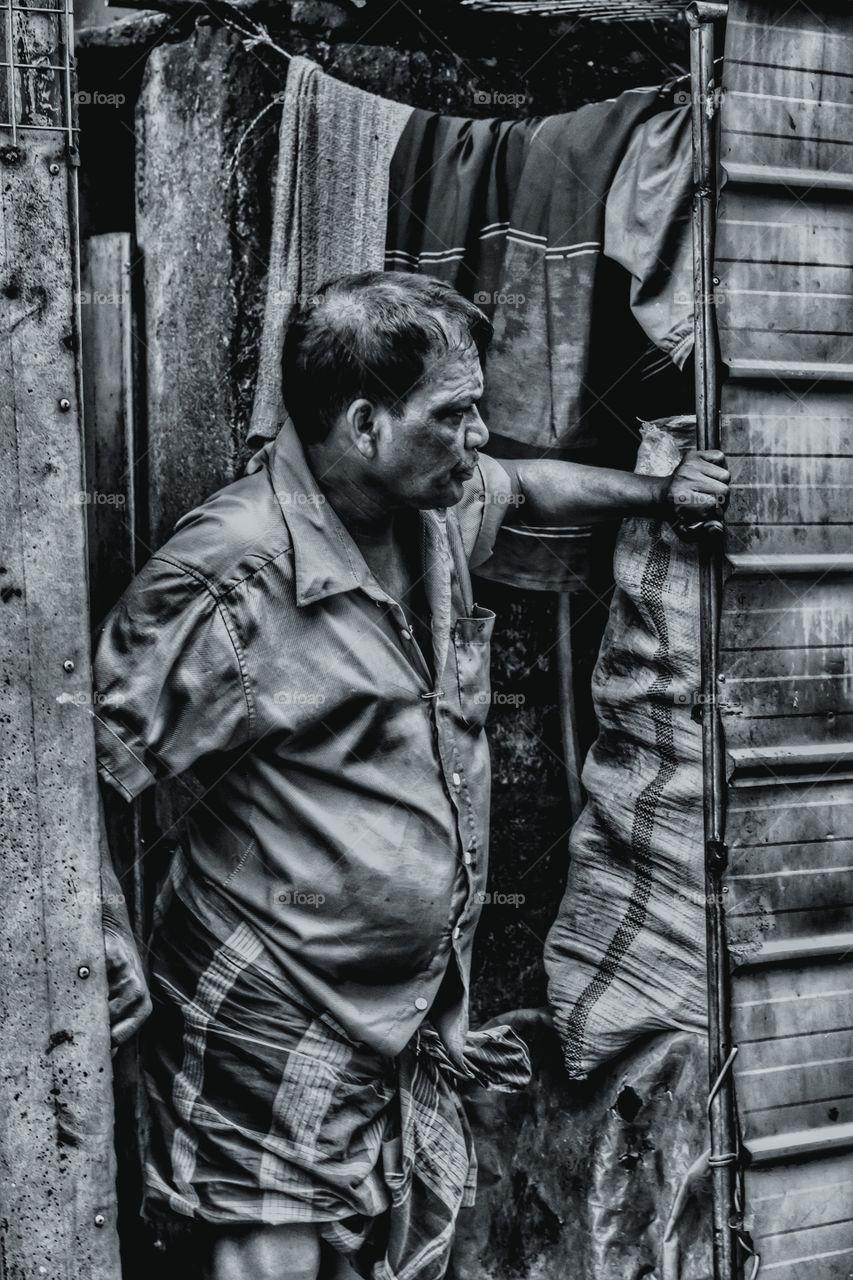 Senior indian man standing near doorway