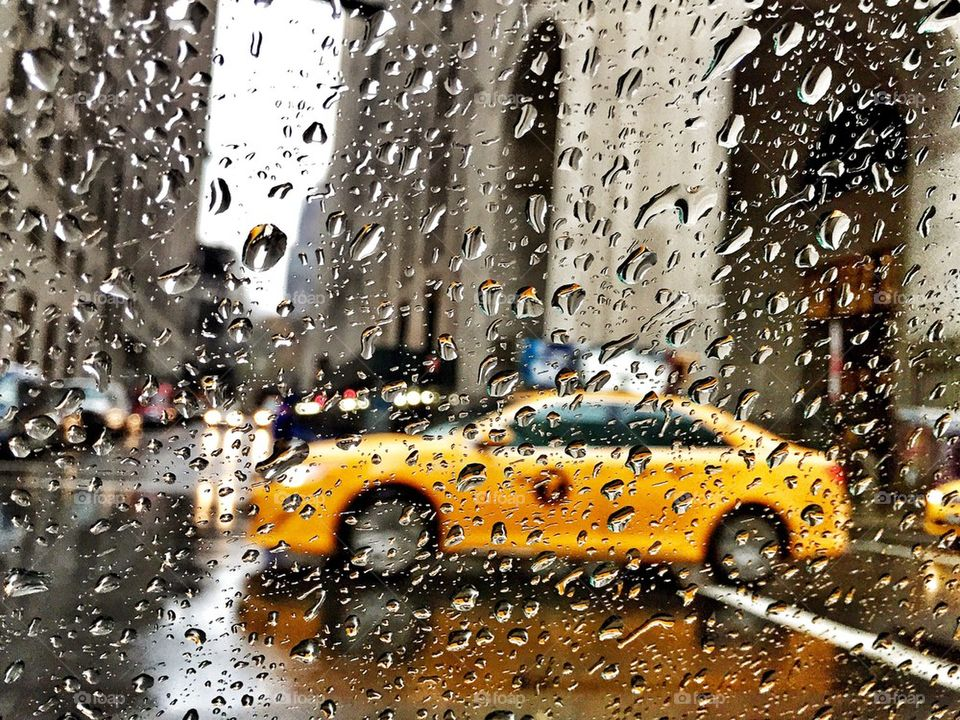 Yellow cab in the rain