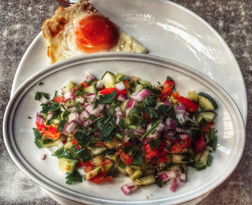 Fried egg with fresh seasonable salad