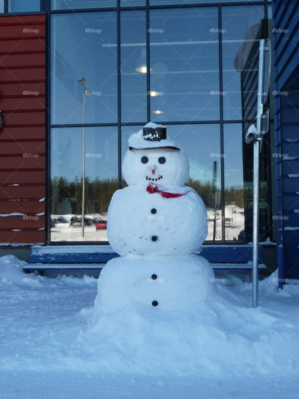 Snowman in front of an Airport