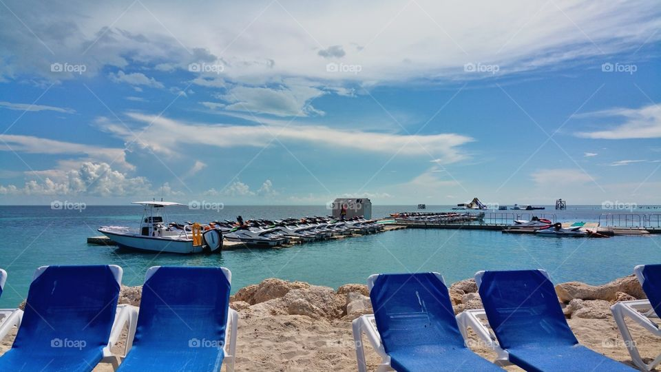 View from Coco cay island. . lounge chairs boat, jet skies, water park.. Bahama's