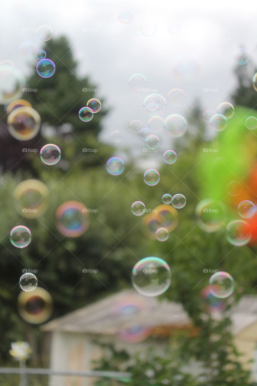 View of colorful bubbles from window