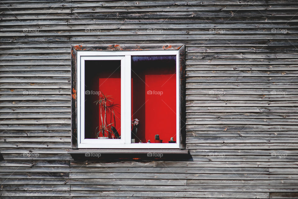 Wooden wall red window