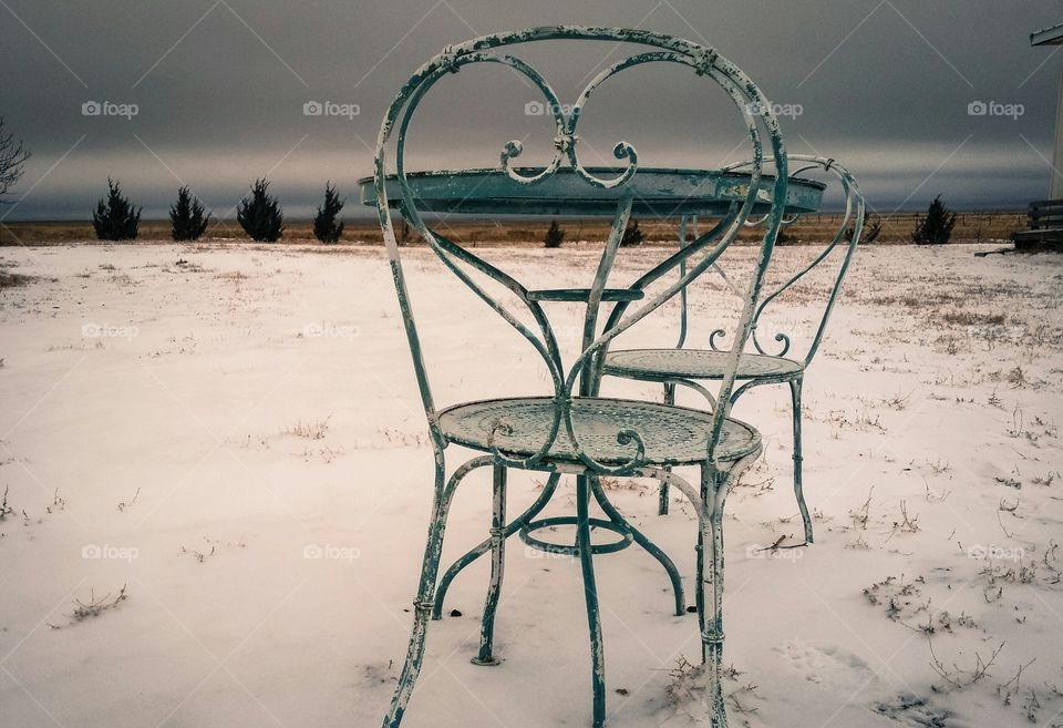 Close-up of chairs on snow