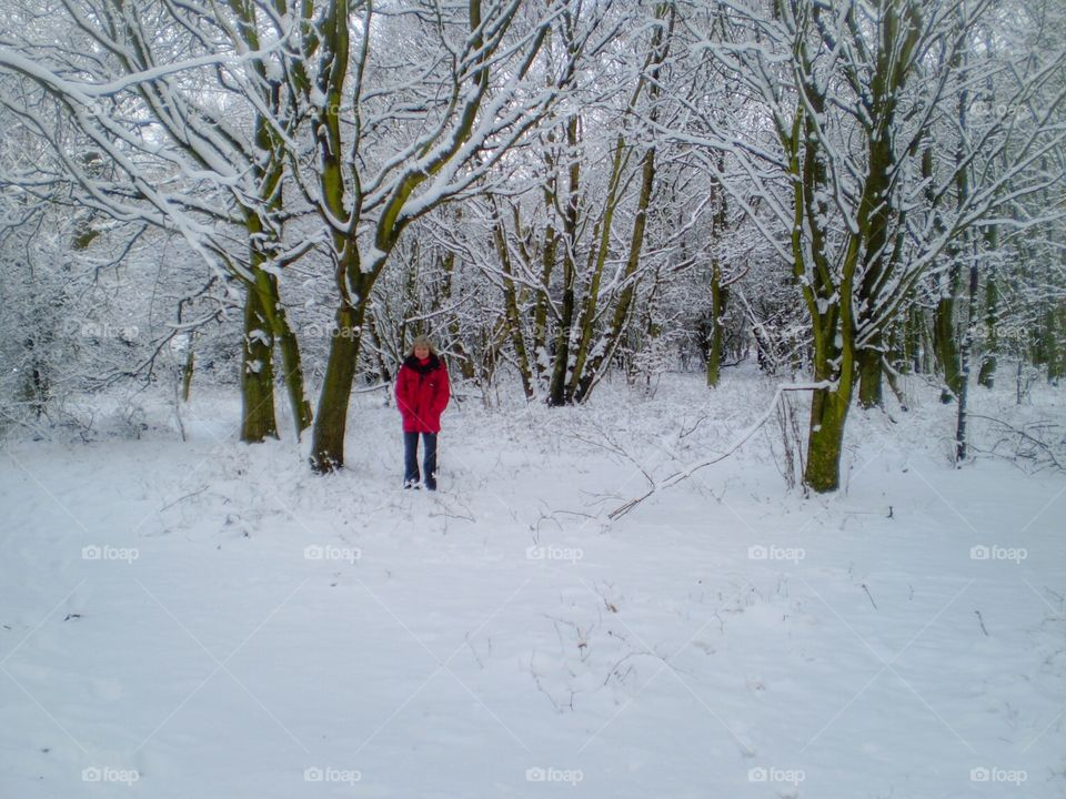 Young woman standing in snowy landscape
