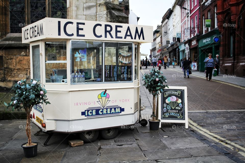 An Ice Cream van on a city street.