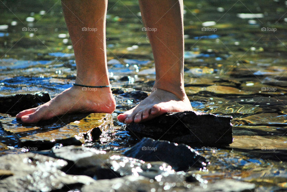 bare Feet on waterfalls feeling the cold water
