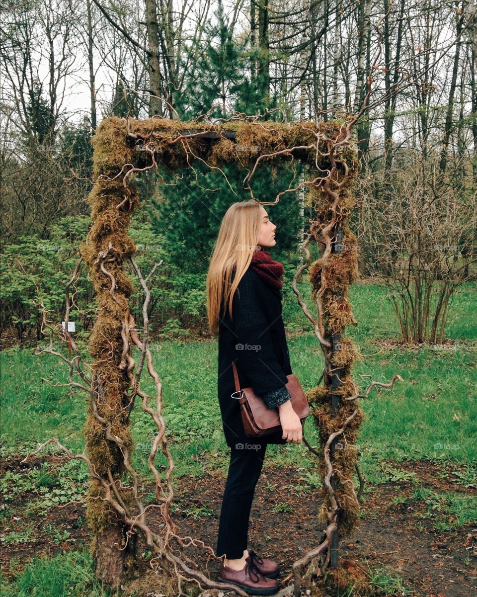 Woman standing tree frame