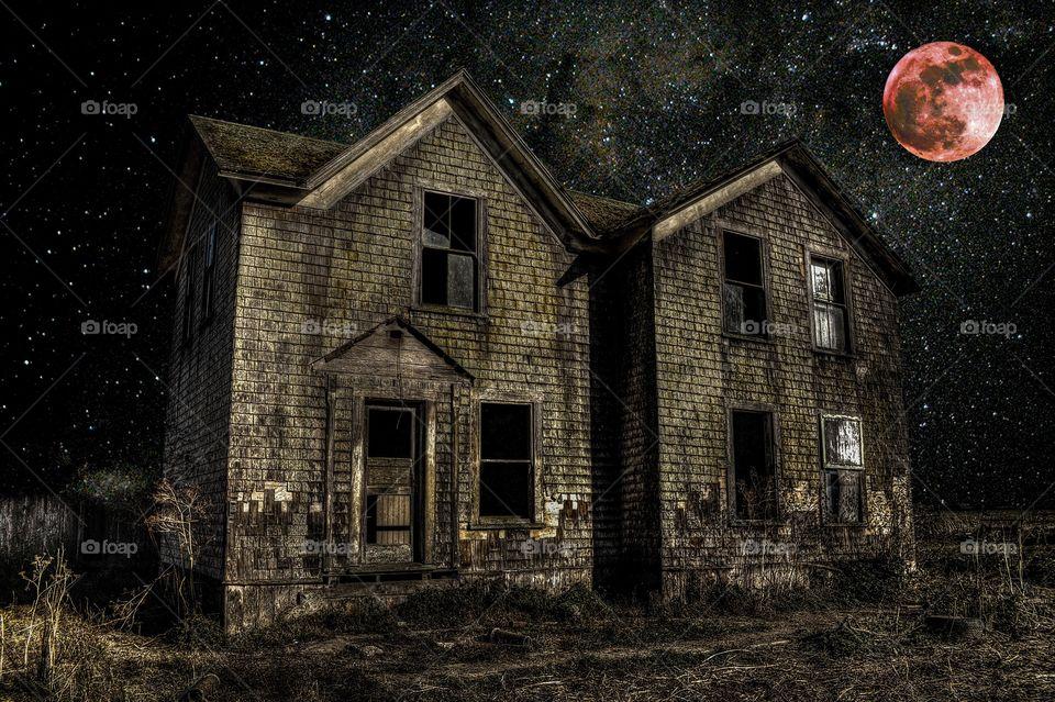 Abandoned rural house at night