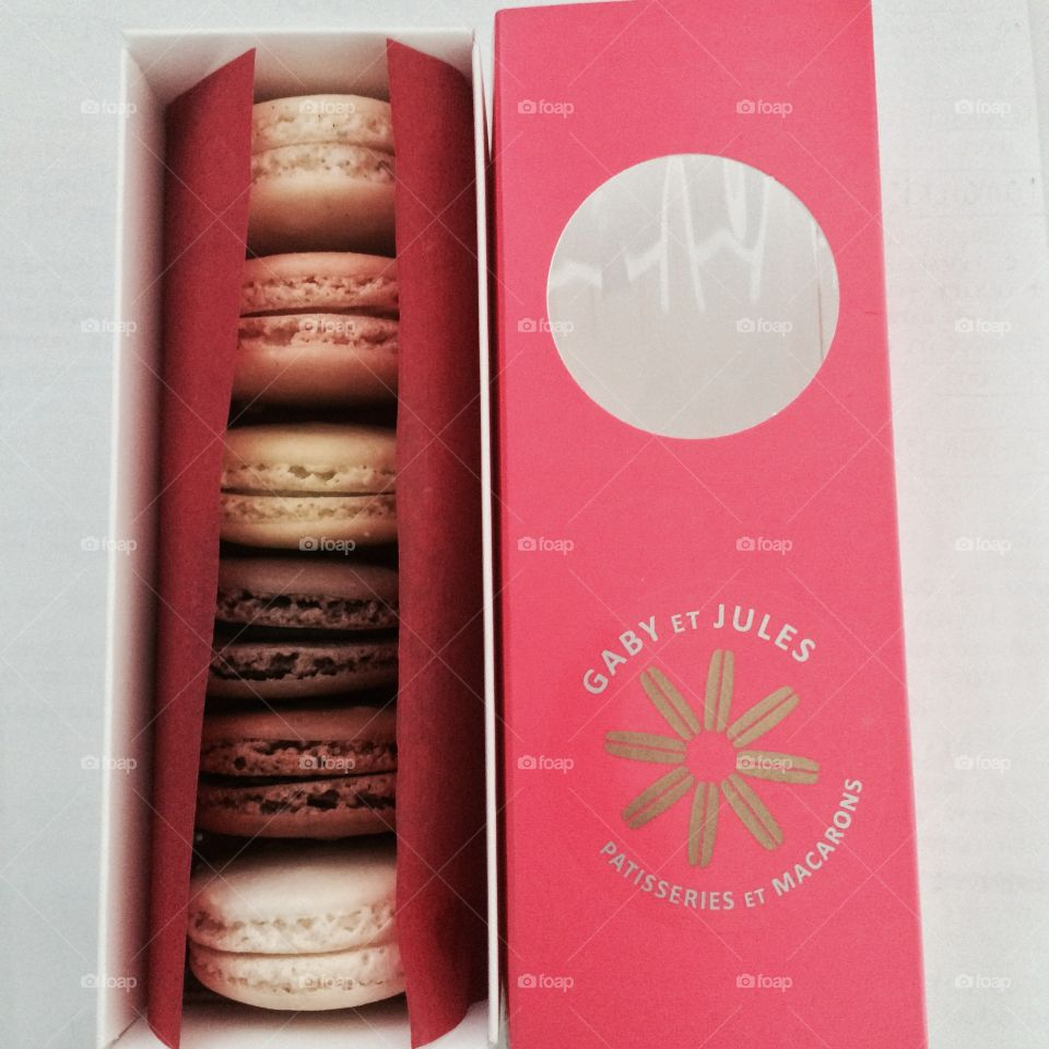 Bright and cute packaging for a sleeve of macarons of assorted flavors. 6 different and tasty flavors.