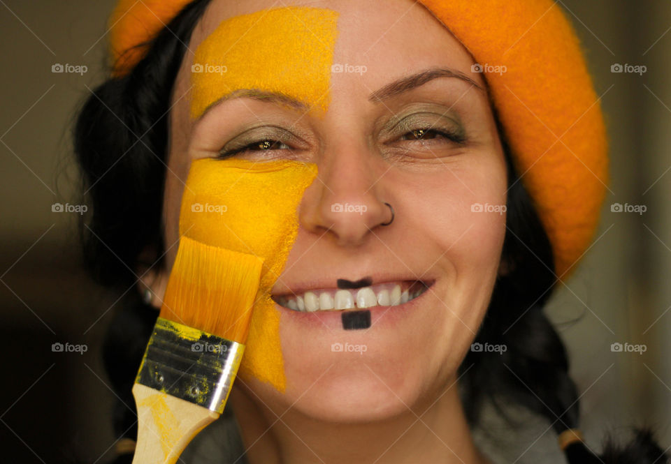 Happy smile, portrait of a woman, close up, paint your life in color - yellow
