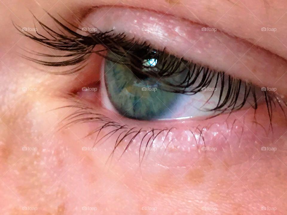 Close-up of green eyes