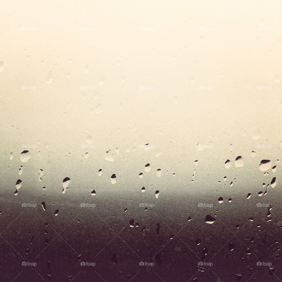 Close-up of rain drops on window