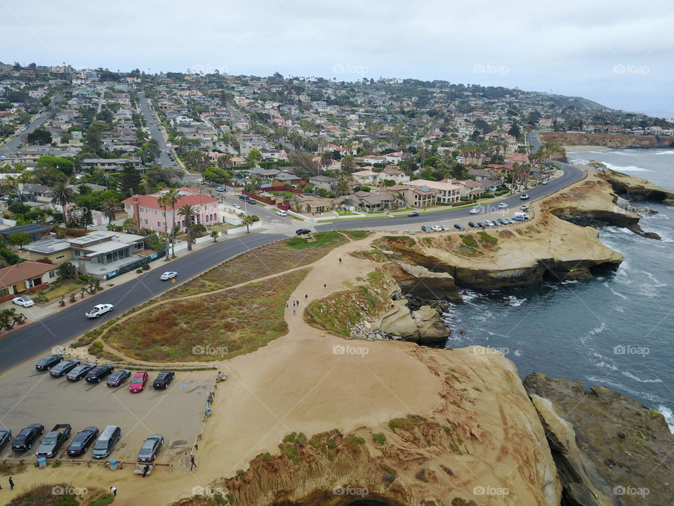 https://en.m.wikipedia.org/wiki/List_of_beaches_in_San_Diego This is a list of beaches in the San Diego area in Southern California, USA. This article actually contains two sequential lists: a list of beaches in San Diego's North County, and a list of beaches that are within the city limits of San Diego. The beaches are listed in order from north to south, and they are grouped (where applicable) by the community in which the beach is situated.  Some beaches in the San Diego area are long continuous stretches of sandy coastline, others, like many of the beaches in the Village of La Jolla (which was built on a large rocky promontory), are small sand beaches within rocky coves or between rocky points. A number of beaches in the San Diego area have cliffs behind them, usually composed of rather soft sandstone; some other beaches front freshwater lagoons where rivers run into the coast.