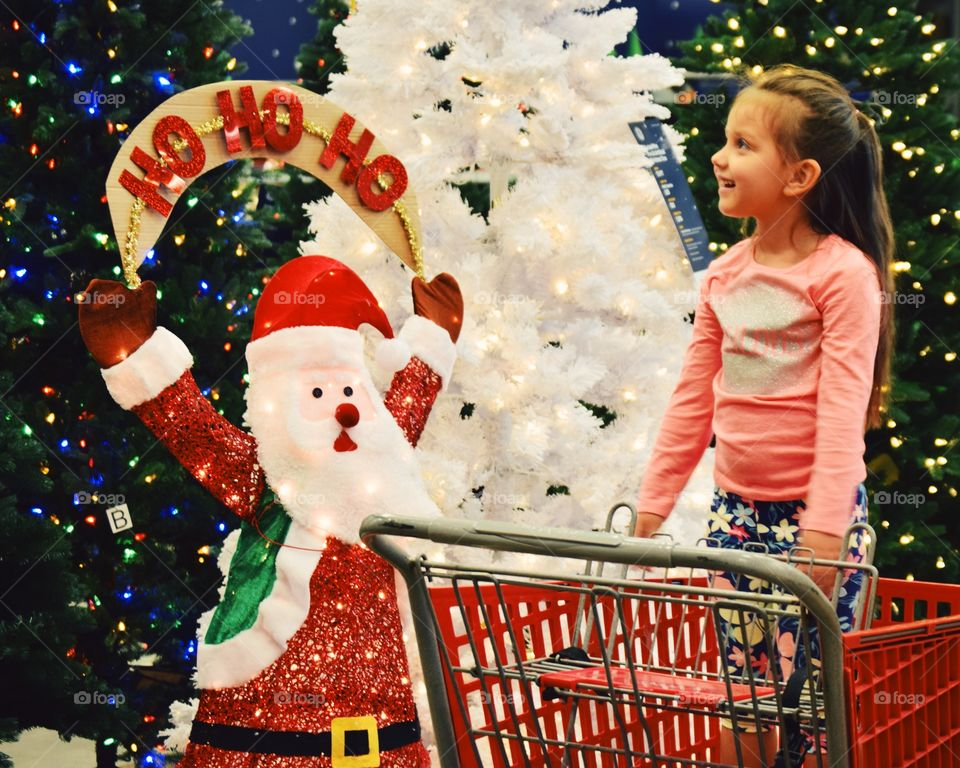Smiling girl looking christmas decoration