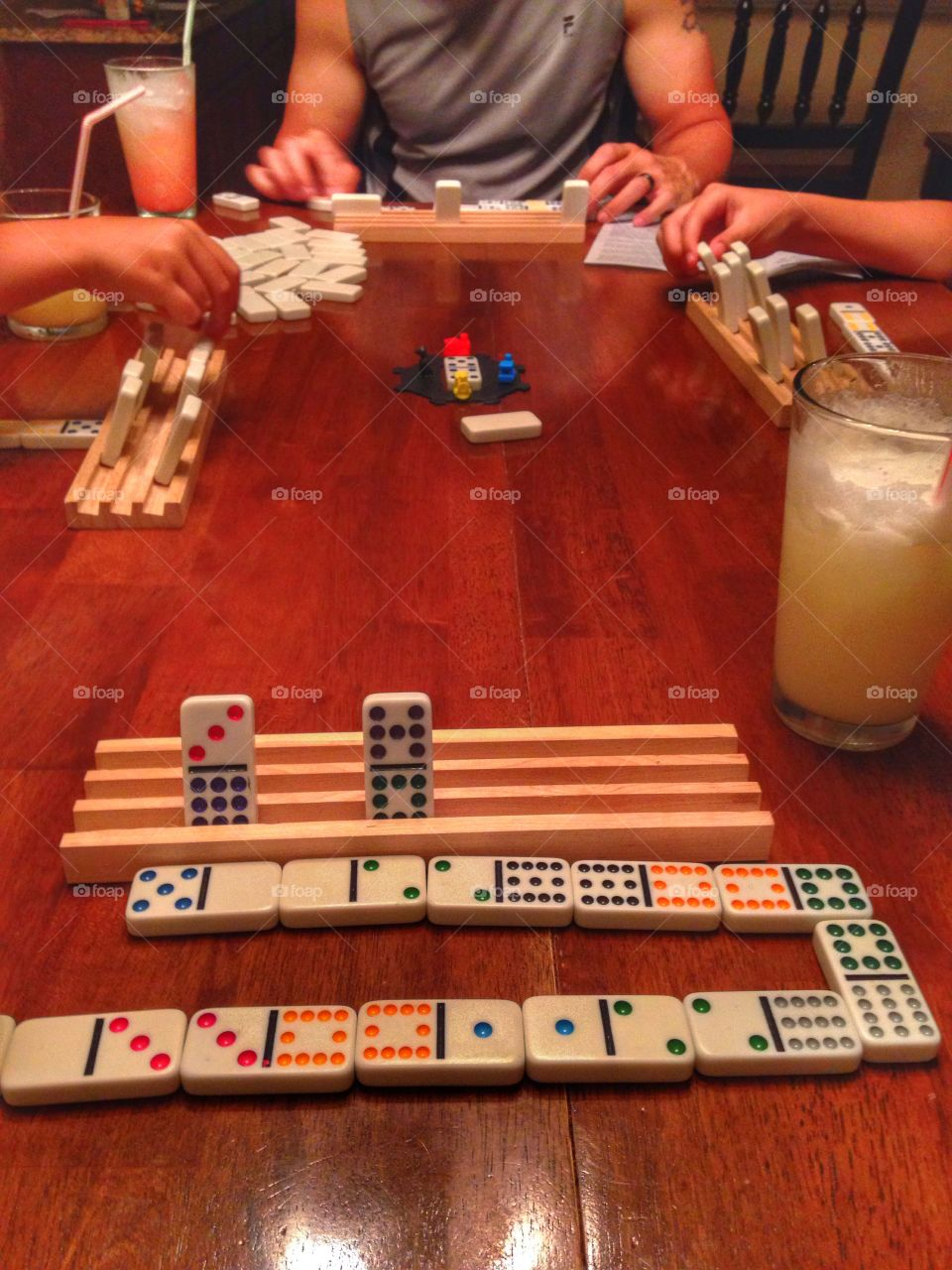 Family game night . Family playing a game of Mexican train