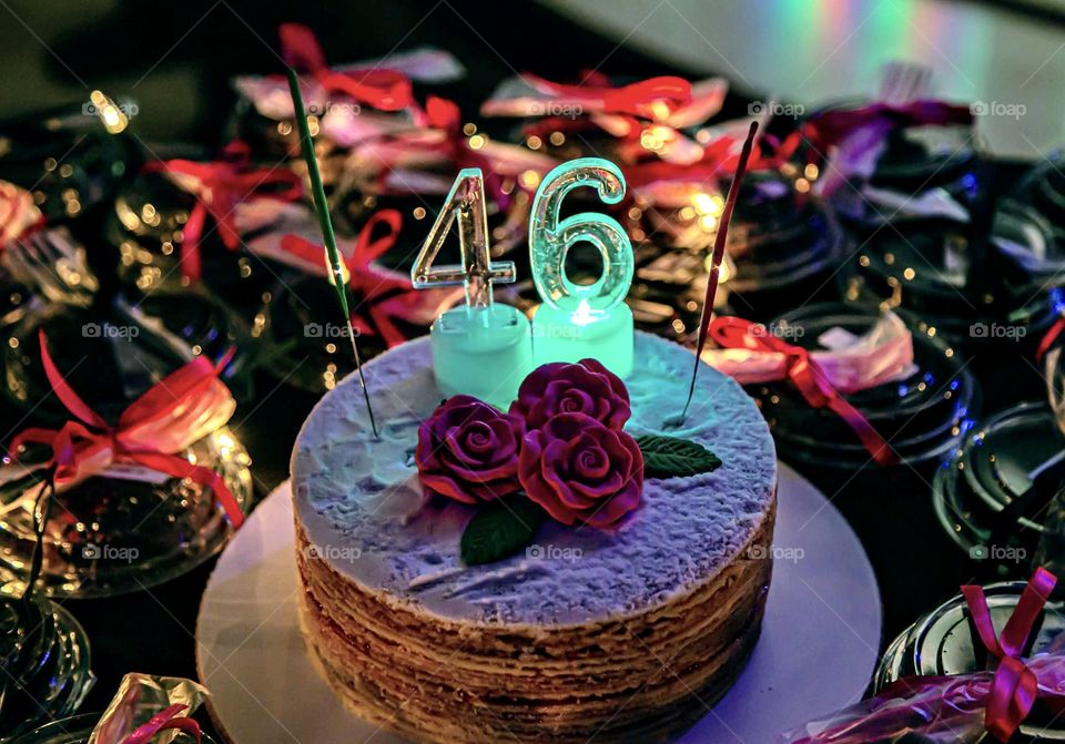 Birthday cake on black end pink background