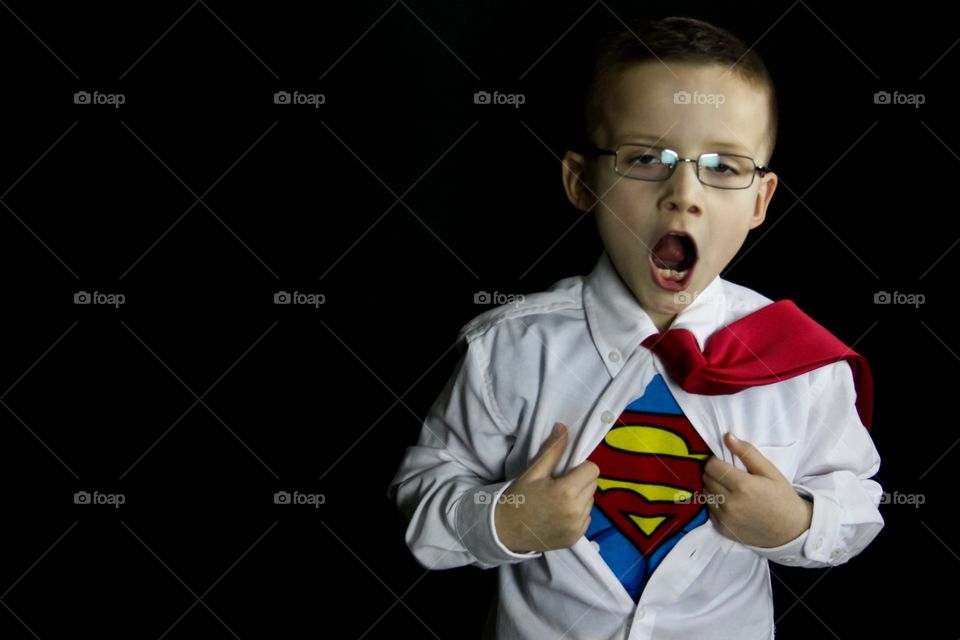 Superhero unbuttoning his shirt