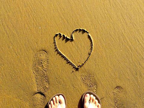 Heart shape on sandy beach
