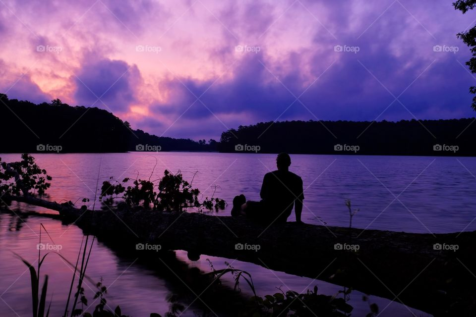 I only had a 10 second delay, so I had to reach down deep to find a combination of coordination and grace to get into this peaceful position without plunging into the lake... Lake Johnson in Raleigh North Carolina.