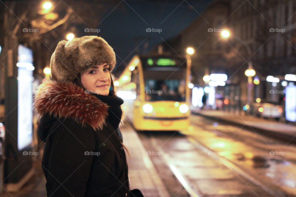 A girl tourist portrait with a blurred tram in the background