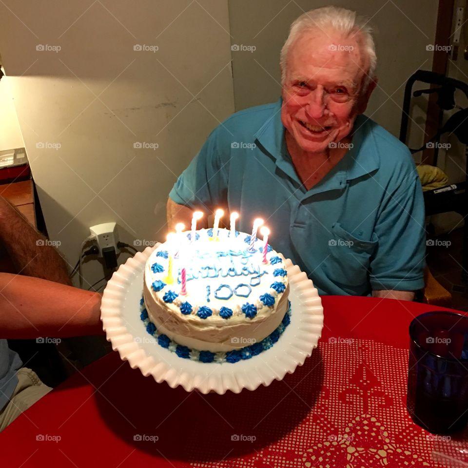 Birthday cake handmade, candles all lit, age 100.