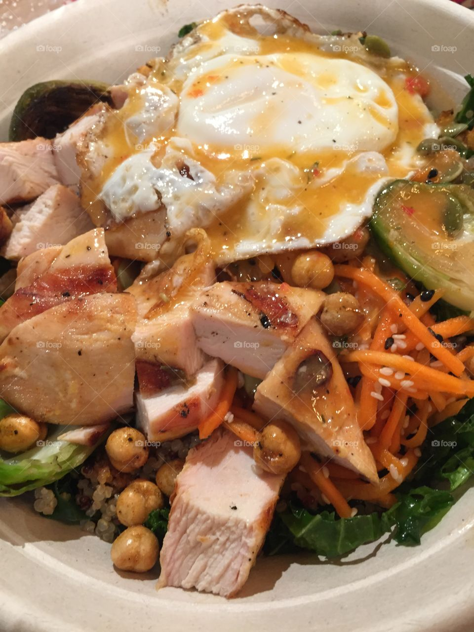 Kale salad with chicken and quinoa and carrots and other good veggies