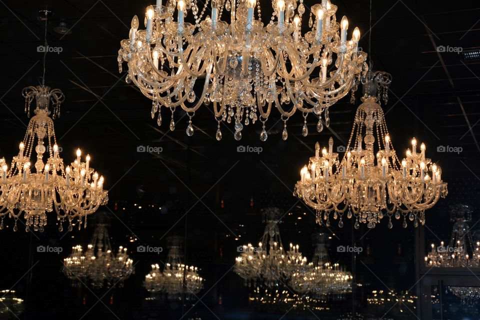 many lamps reflected in the mirror