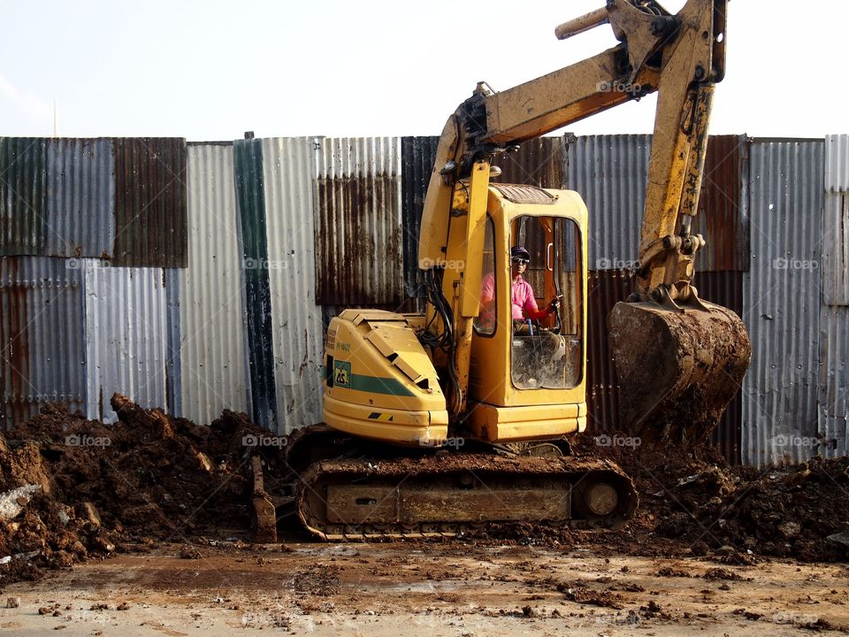 backhoe digger excavator. a heavy equipment  truck called excavator at a construction site