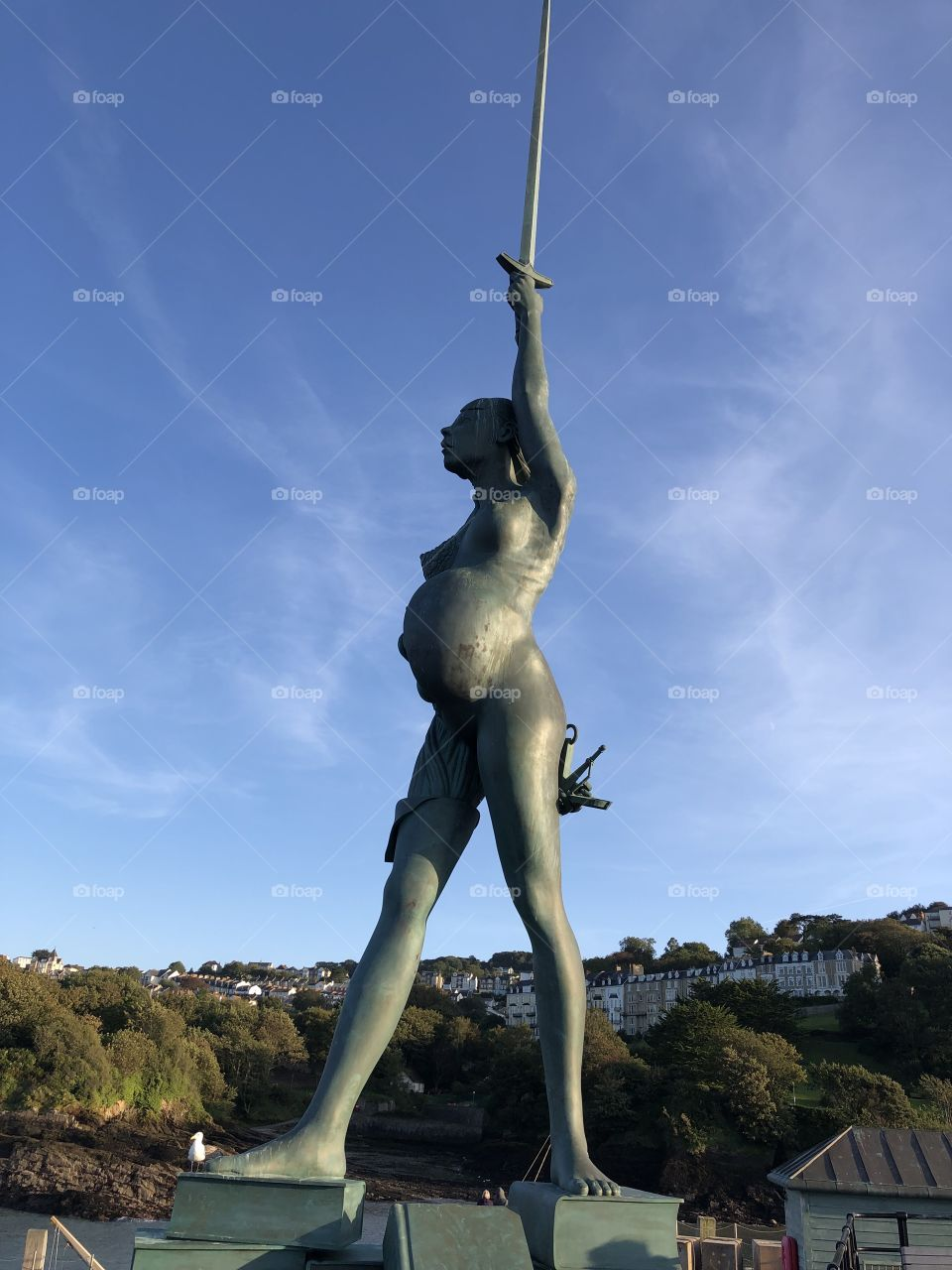 """This is a huge sculpture created by the famous artist Damien Hirst, it represents """"truth and hope"""" and can be located in Ilfracombe in Devon, UK."""