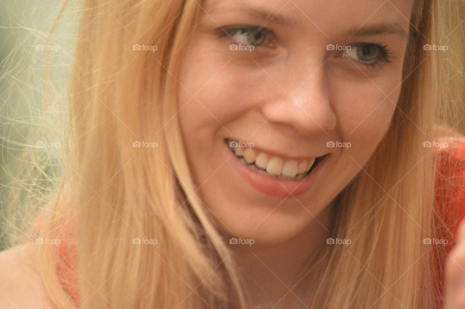 Close-up of blonde woman smiling
