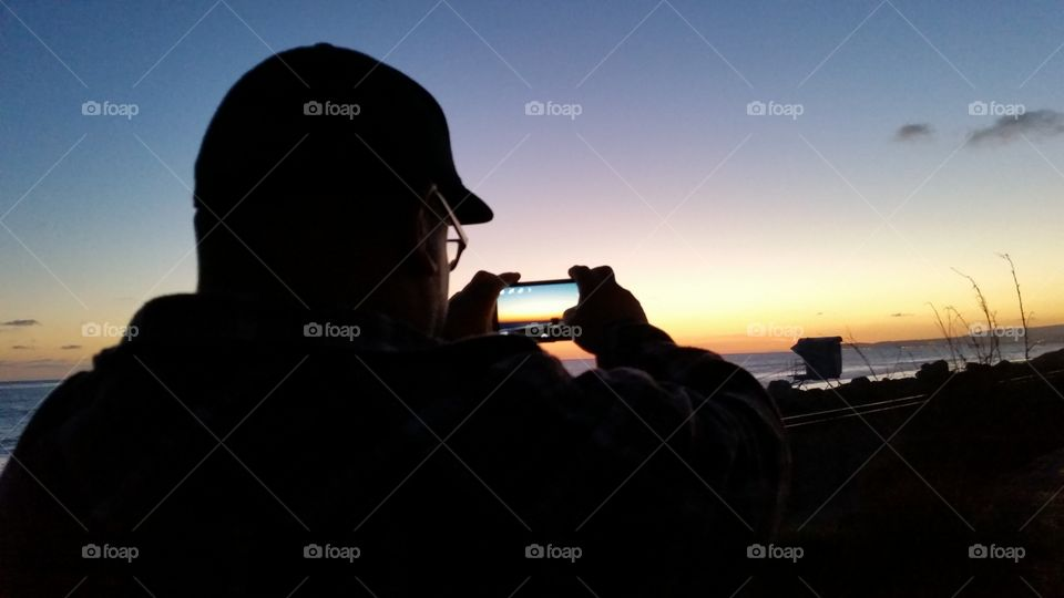 A photo in a photo. On the beach in Dana Point taking a photo of my man photographing the sunset.