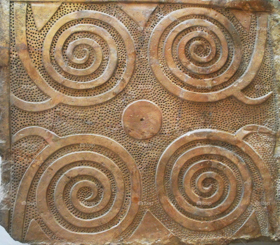 Ancient Mediterranean spiral stone carvings