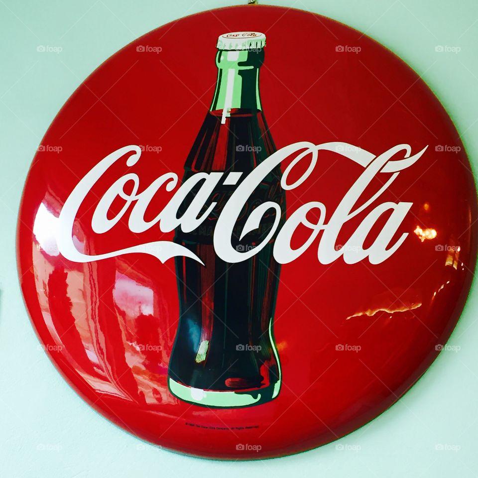 An original Coca-Cola Ad from a still functioning 1950's malt shop diner.