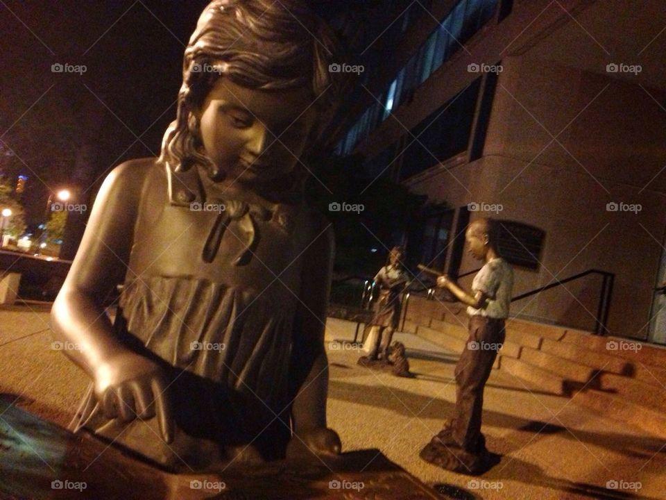 Children statues at night in Midtown Atlanta Georgia