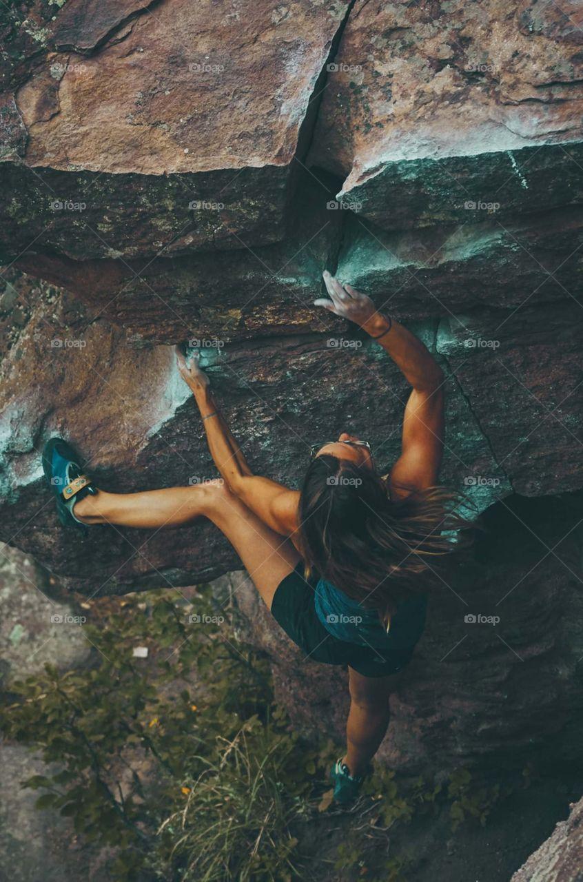 |photo of woman climbing mountain|