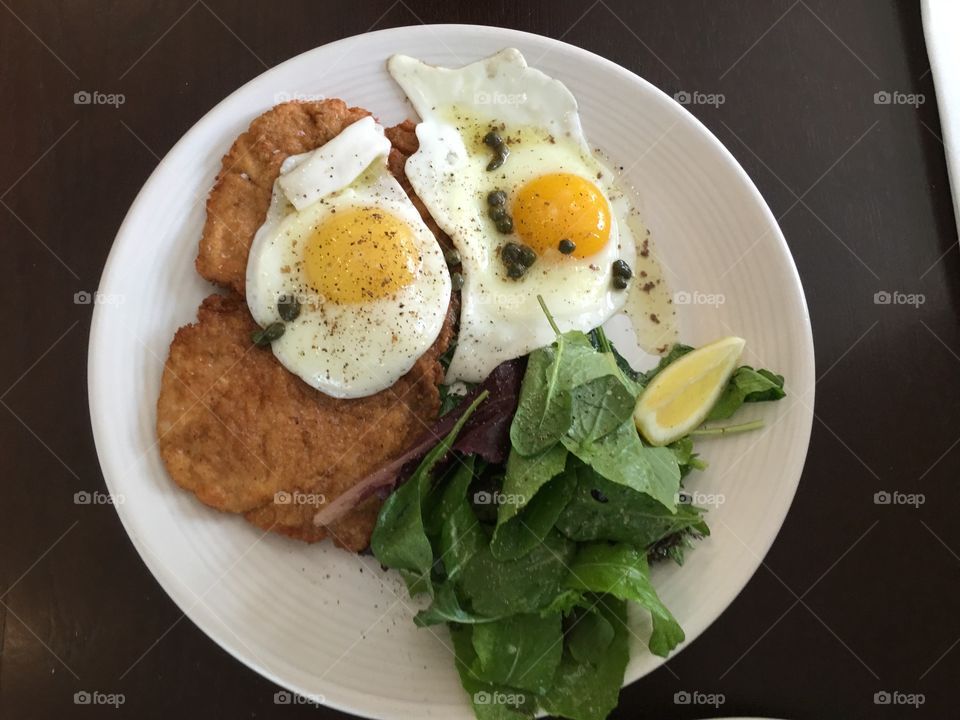 Fried egg and spinach in white plate